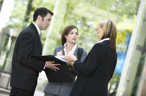 three_business_people_talking